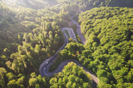 Aerial view of a beautiful mountain road, at sunrise Foto de archivo