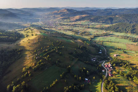 Aerial view above the beautiful mountain village in Bucovina Imagens