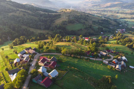 Aerial view of the mountain village in Bucovina Imagens - 129416080