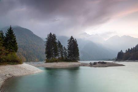 Autumn landscape of Lago del Predil, Italian Alps Stockfoto - 133808064