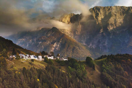 Autumn aerial view of Strmec na Predelu village, at the feet of the Julian Alps, in Triglav national park, Slovenia Stockfoto - 133809391