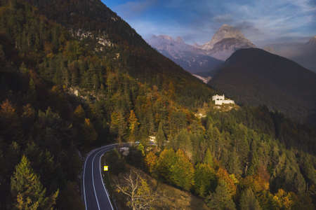 Autumn aerial view of Strmec na Predelu village, at the feet of the Julian Alps, in Triglav national park. Aerial landscape of Fort Predel, in Slovenia Stockfoto