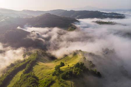Aerial foggy landscape in Transylvania, at sunrise