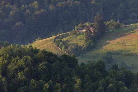 Aerial foggy landscape in Transylvania, at sunrise. Summer sunrise in the Transylvanian village 版權商用圖片