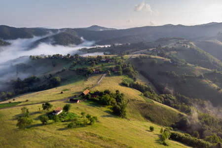 Aerial foggy landscape in Transylvania, at sunrise. Summer sunrise in the Transylvanian village Stockfoto