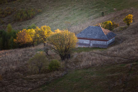 Autumn rural scene of the Romanian village in Transylvania, at the foot of the Carpathian Mountains Imagens