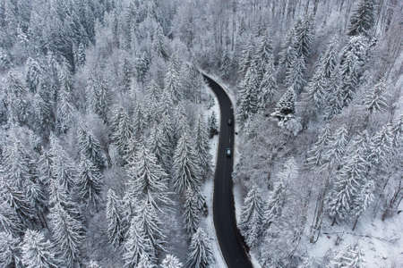 Aerial winter view of the curvy mountain road, in Poiana Brasov