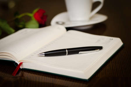 Agenda and pen in the front and a romantic rose and cup of coffe on the back with lots of style