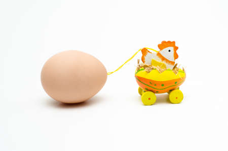 hatched: A hatched chick towing a giant egg for easter Stock Photo