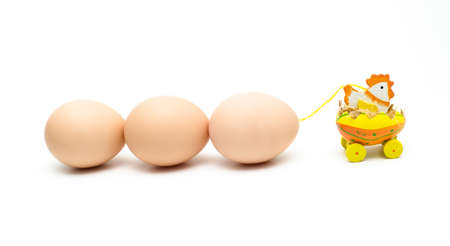 A chicken townig three eggs for easter