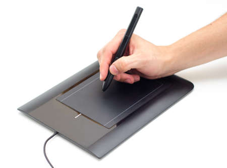 A hand holding a pen stylus and drawing on a tablet
