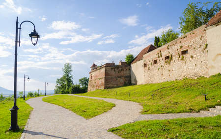 suggesting: Medieval fortress of Brasov walls in Transylvania region of Romania with high defence walls and towers suggesting the countrys rich historic and cultural heritage