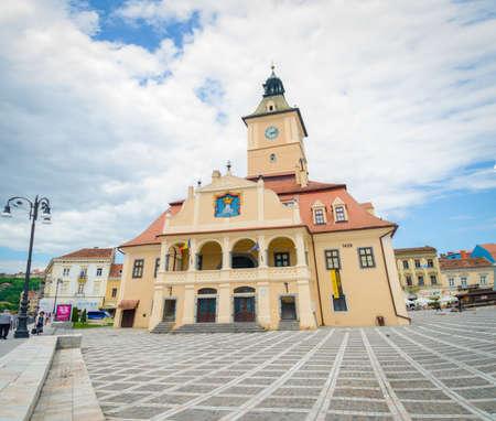 BRASOV, ROMANIA - 29 JUNE: Brasov old medieval romanesque Town Holl in Sfatului Square in the center of the city in Transylvania region of Romania Editorial