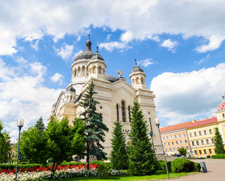 imposing: Orthodox Cathedral in Cluj-Napoca Avram Iancu Square  Transylvania region of Romania on a beautiful blue sky day with an imposing look for the religious historical monument