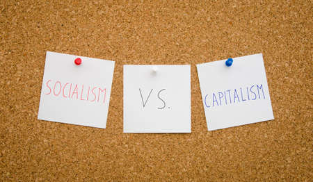 socialism: Debate between socialism and capitalism regarding national politics suggested by [inned notes on a board concept