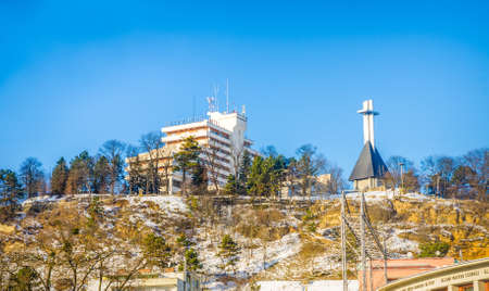 cetatuia: CLUJ-NAPOCA, ROMANIA - 06 JANUARY 2015:View of Cetatuia hill with the monument and Belvedere Hotel on a sunny winter day with snow and a blue sky and the hungarian opera house on the right Editorial