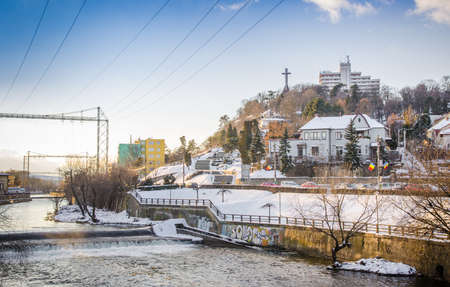 cetatuia: CLUJ-NAPOCA, ROMANIA - 6 JANUARY 2015:Belvedere Hotel Cetatuia hill and monument and the Somes River on a cold sunny winter day with a beautiful sunset Editorial