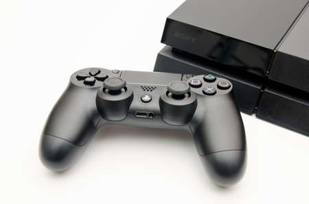 CLUJ-NAPOCA, ROMANIA - 25 FEBRUARY: Illustrative editorial image of Sony Playstation 4 console with Dualshock 4 controller on a white isolated background suggesting new technology in gaming hardware with a modern design with the logos 에디토리얼