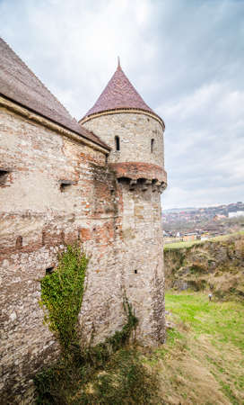 fortified: Old medieval historic fortified tower from the Corvinilir Castle in Transylvania region of Romania with a blue cloudy sky Editorial