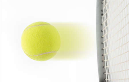 Fast speeding tennis ball being hit by a raquet suggesting a winner in a match