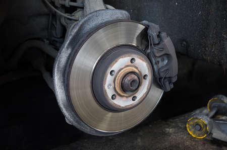 braking: Braking system with disk at a shop having tyres changed suggesting safety maintenence and service