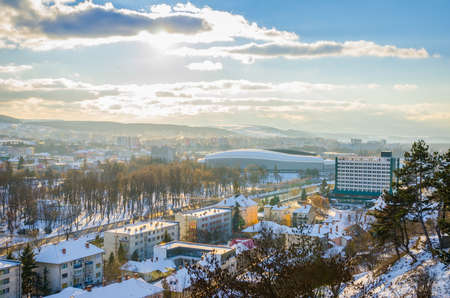 napoca: CLUJ-NAPOCA, ROMANIA - 06 JANUARY 2015: View of Cluj Arena, Cluj Napoca Central Park and Napoca Hotel on a sunny winter day with beautiful white snow and sunrays Editorial