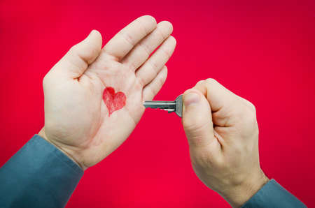 suggested: Finding the key to love suggested by a man holding a key and a heart in his palm
