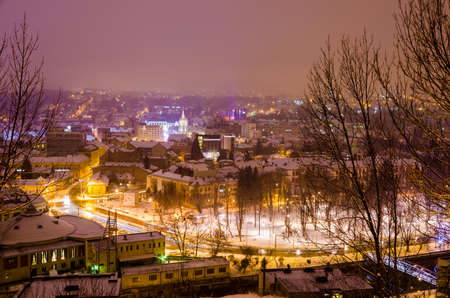 faculty: Cluj Napoca view on a cold winter night with the Hungarian Opera House, The Faculty of Chemistry and Central Park with snow and beautiful lights Stock Photo