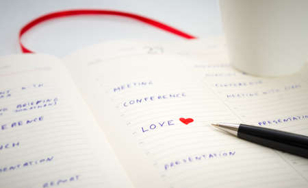 spouse: Putting love for a spouse on a busy businessman schedule date concept