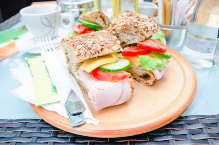 Ham tomatoe cucumber and lettuce sandwich in rustic seed bread Stock Photo