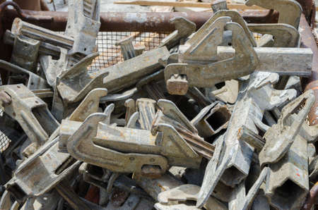 Truss connection parts in a pile at a construction site made out of steel with a used old rusted industrial heavy look Stock Photo
