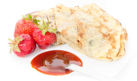 Pancakes folded with fresh strawberries and strawberry jam on a spoon Stock Photo