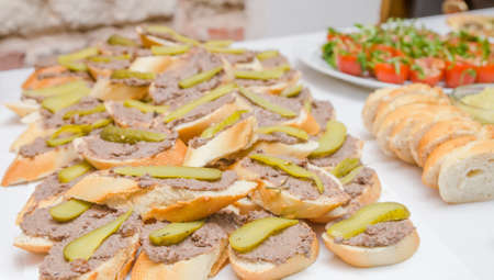 stilish: A pile of pate appetizers on small slices of bread at a restaurant