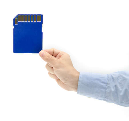 suggesting: Huge portable storage space in the hand concept with a blue sd card and a business man hand in a suit suggesting cloud server