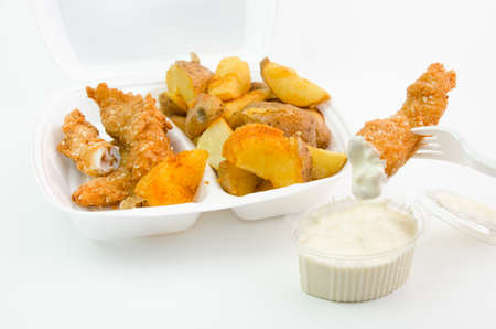 strips away: Chicken and potatoes to go in a plastic caserole with mayonaise Stock Photo