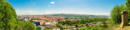 cetatuia: Wide cityscape view of Cluj-Napoca in Transylvania region of Romania on a sunny summer day