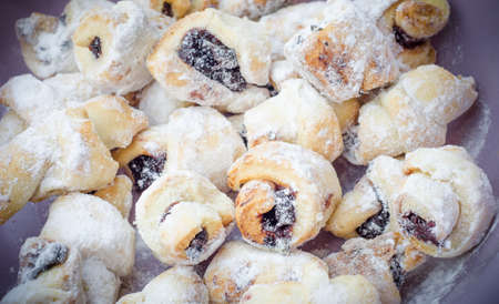 crescent: Crescent roills with jam and sugar Stock Photo