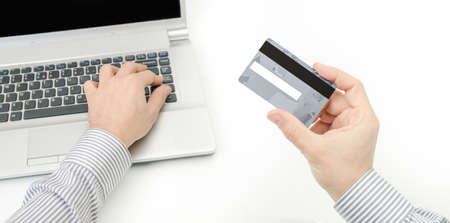 hacked: A business man securing a credit card to prevent online bank account from being hacked