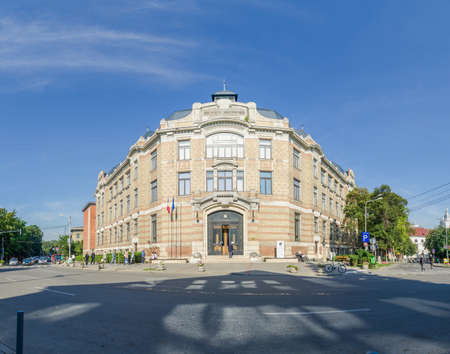 cluj: CLUJ-NAPOCA, ROMANIA - 24 AUGUST 2015: Central University Library of Cluj Napoca also named after romanian writer Lucian Blaga in Cluj Napoca, Transylvania region of Romania built in art nouveau or wiener secession architectural style Stock Photo