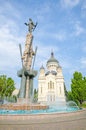 eastern european: Orthodox Cathedral and national hero Avram Iancu statue in Cluj Napoca, transylvania region of Romania on a sunny summer day. Beautiful romanian church in the center of this eastern european tourist attraction