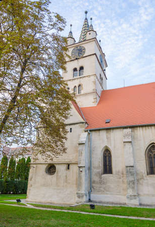 SEBES, ROMANIA - 4 OCTOBER 2015: Sebes evanghelic church with the bell and clock tower in the center built during the 13th centruy in a romanic and later in a gothic style Stock Photo