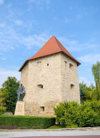 15th century: Tailors Bastion in Cluj Napoca city, Transylvania region of Romania. A medieval defence tower built during the 15th century and curently being used as an exhibition center and museum with the statue of national hero General Baba Novac in the front