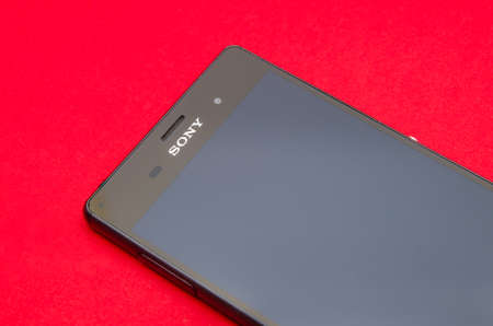 sony: CLUJ-NAPOCA, ROMANIA - 12 AUGUST 2015: Sony Xperia Z3 smartphone on red alerted background suggesting problems and repair and fix services with the Sony logo in focus