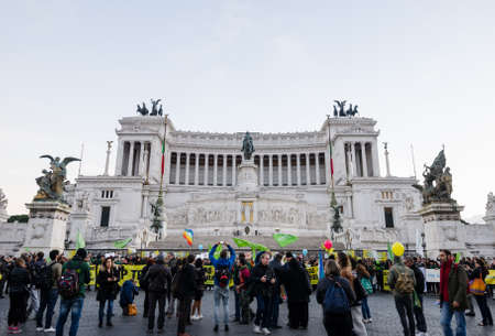 dedicated: ROME, ITALY - 1 December 2015: Mausoleum of Emmanuel  Vittorio Due II dedicated to the heroes of Italy with a protest or riot in front