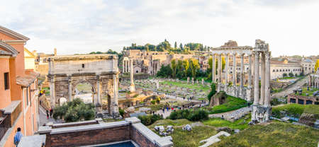 ROME, ITALY - 1 December 2015: Ancient roman ruins on the site of the Temple of Saturn and Arco di Settiemo Severo