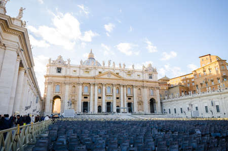 ROME, ITALY - 28 November 2015: Basilica of Saint Peter in the holy Vatican State with seating and people in the Square Editorial