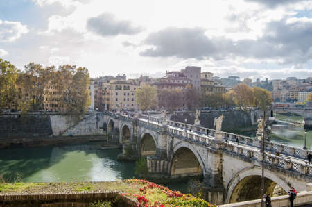 ROME, ITALY - 1 December 2015: Ponte Aelius bridge over the Tiber River with the old city and a sunny blue cloudy sky Editorial