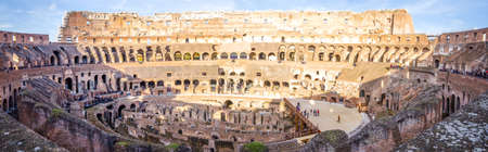 ROME, ITALY - 29 November 2015: Panoramic wide view of the interior of the Colosseum in Rome, a wonderful ancient historic site with lots of visitors