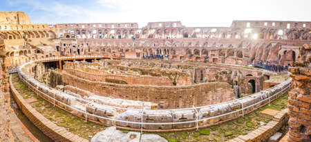 seating area: ROME, ITALY - 29 November 2015: Colosseum interior wide panoramic view from the seating area with lots of tourists visiting this monumental ancient european touristic attraction