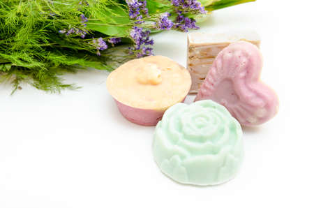 Natural hand made soap from organic herbs and plants with lavander essence and plants on the background suggesting healthy products